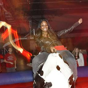 photo: student rides a mechanical bull
