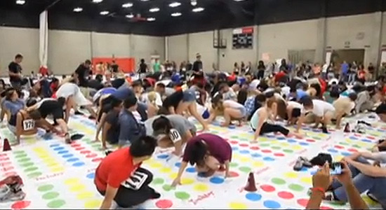photo: students playing the giant Twister game