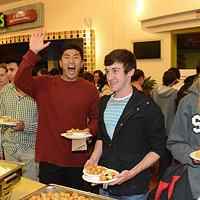 photo: happy students with plates of food