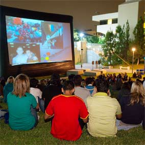 photo: students watch a movie outdoors