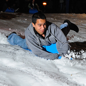 photo: student riding a sled