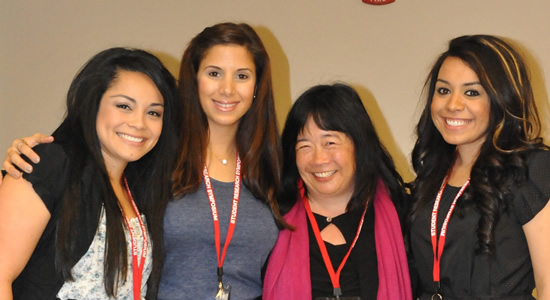 Dr. Hokoda with Students at Research Symposium
