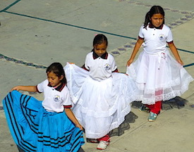 Photo: 3 little girls dancing in pretty skirts
