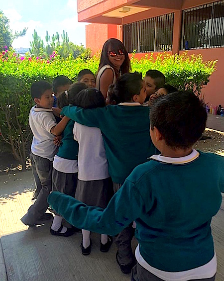 Photo: Adriana receives hugs from intervention group