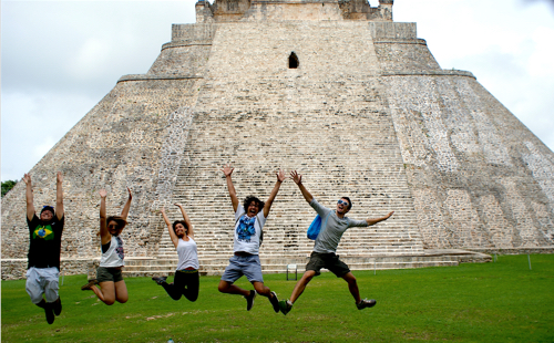 Photo: Students jump in front of Uxmal pyramid