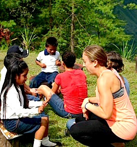 Photo: SDSU teacher scholar chats with local child outdoors