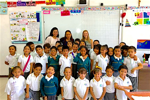 Photo: Class EL scholars pose with children in classroom