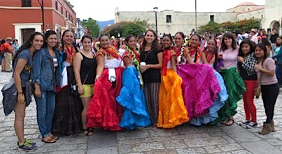 Photo: Students pose with dancers in colorful dresses