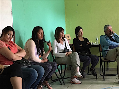 Photo: CLASS EL participants sit in front of colorful walls
