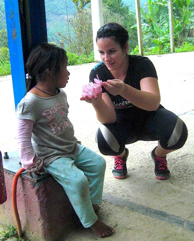 Photo: Diana interacts with a child in Chinantla