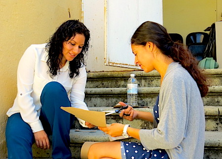 Photo: Evelyn Ontiveros and Amanda Estrada sit on steps and talk