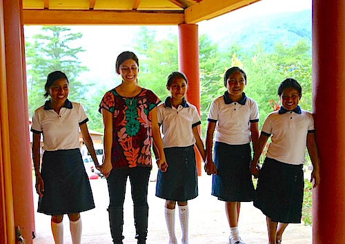 Photo: SDSU teacher scholar poses with school girls