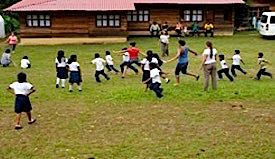 Photo: Kids play supervised outdoor lawn games