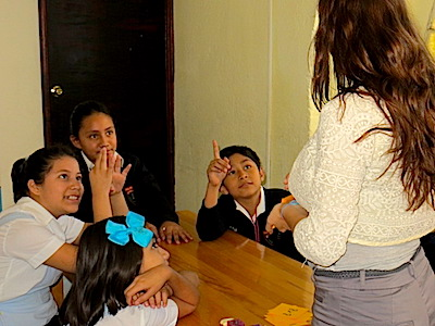 Photo: Students engage with teacher in a math skills group