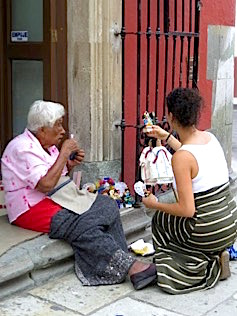 Photo: Scholar and aging woman on local street beside building