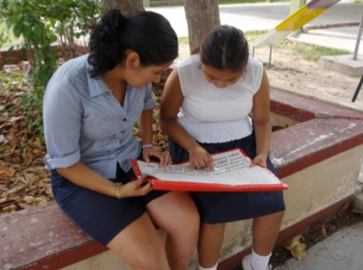 Photo: trainee helping student in Mérida, 2014