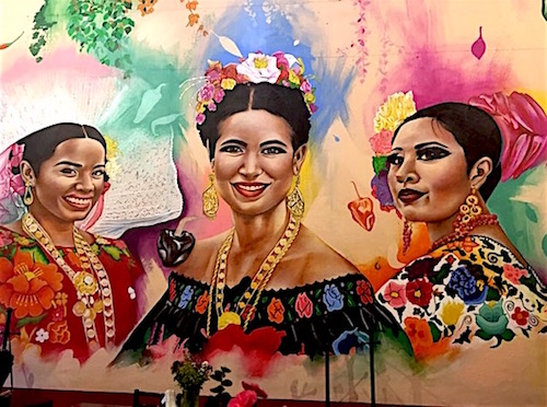 Photo: Several Mexicanas depicted in traditional dress in colorful mural