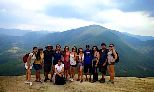 Photo: Group pose in front of mountains