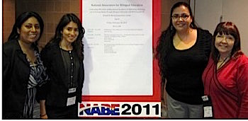 Photo: 4 students pose with presentation board at NABE 2011
