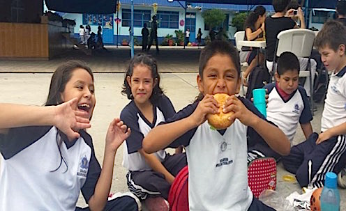 Photo: Young students enjoying lunch