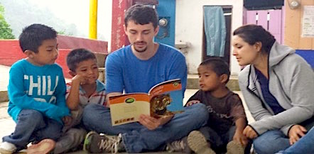Photo: Reading to a group of young children