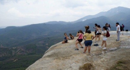 Photo: Immersion students mountain view from rock ledge