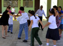 Adults and kids at play in Mexican schoolyard