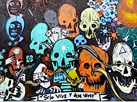 Photo: mural with colorful human skulls