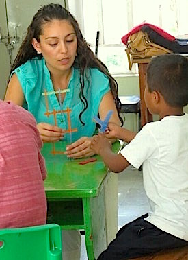Photo: Teacher scholar and student do craft project