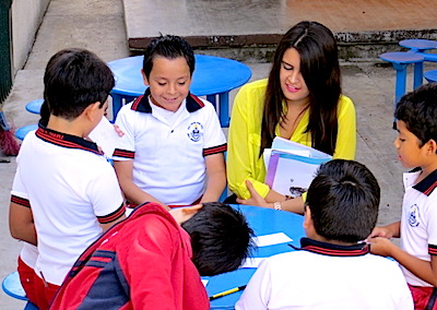 Photo: students and teacher read together