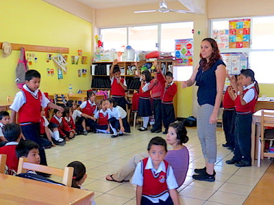 Photo: students and teacher in classroom activity