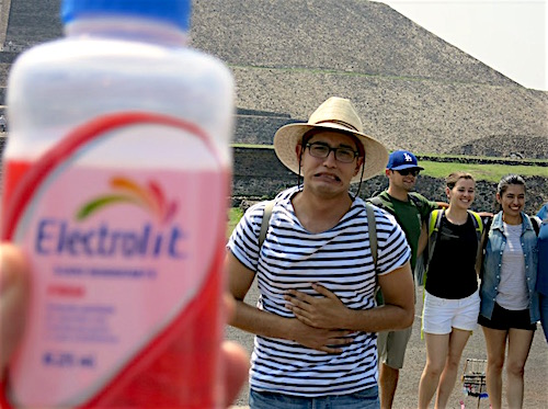 Photo: Posing with tummy ache medicine in front of pyramid