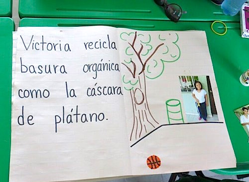 Photo: Child's poster that reads, in Spanish, Victoria recycles organic garbage to help the planet