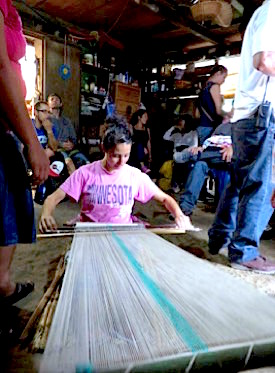 Photo: Loom weaver