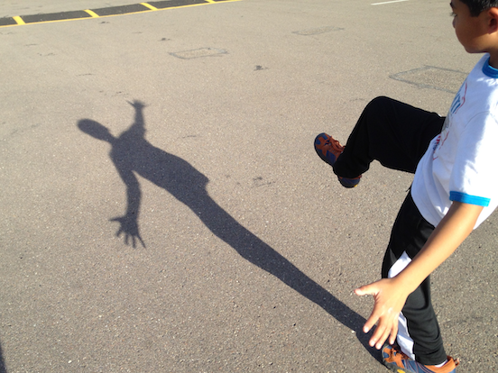 Boy examining his shadow