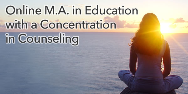 Woman meditationg in front of sunset