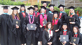 Group of EDL graduates in cap and gown