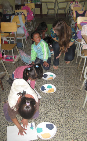 Helping the children in the classroom