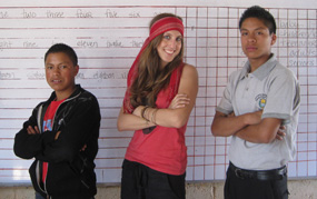 Nahomi with two students