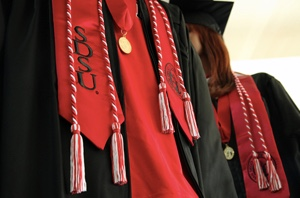 Photo: SDSU students in graduation gowns and regalia
