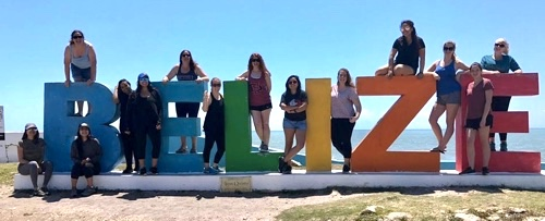 Photo: SDSU students pose with Belize beach statue