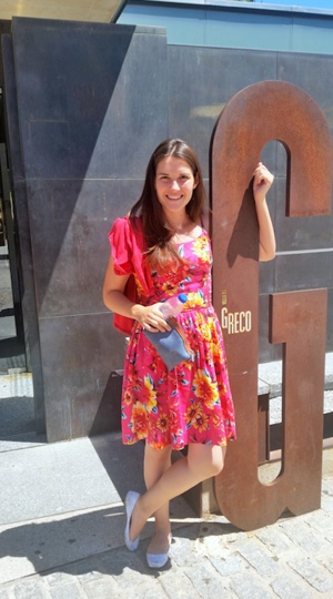 Photo: Caitlin Roth posing next to metal sculpture in shape of the letter G that says El Greco