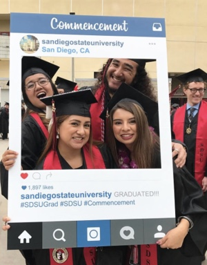 Photo: SDSU students at commencement posing with Commencement SDSU San Diego CA instagram prop