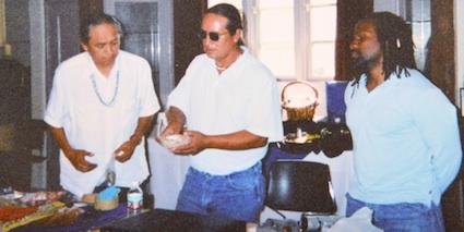 Photo: 3 guys prepare food