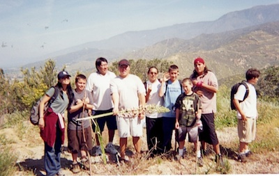 Photo: boys hiking group. All Tribes students with Mimo Masuda (Japanese), Eugene Honanie (Hopi), Richard Aisaican (Cree) and Adrian Dorris
