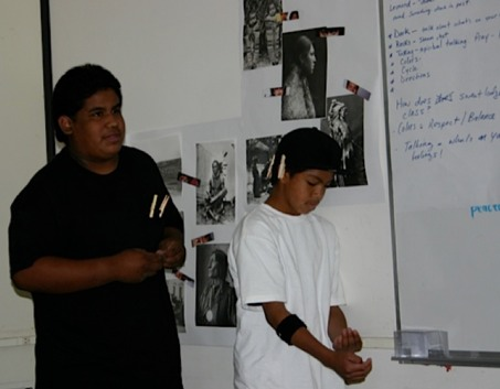 Photo: Two students at whiteboard