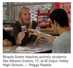Shayla Green teaches autistic students like Alberto Castro, 17, at El Cajon Valley High School. —Peggy Peattie