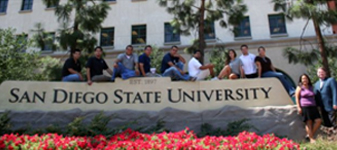 MEP students sitting around SDSU sign