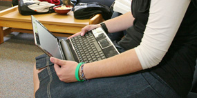 student using a laptop computer