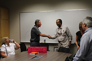 Dr. German shaking hands with Dr. Beyene